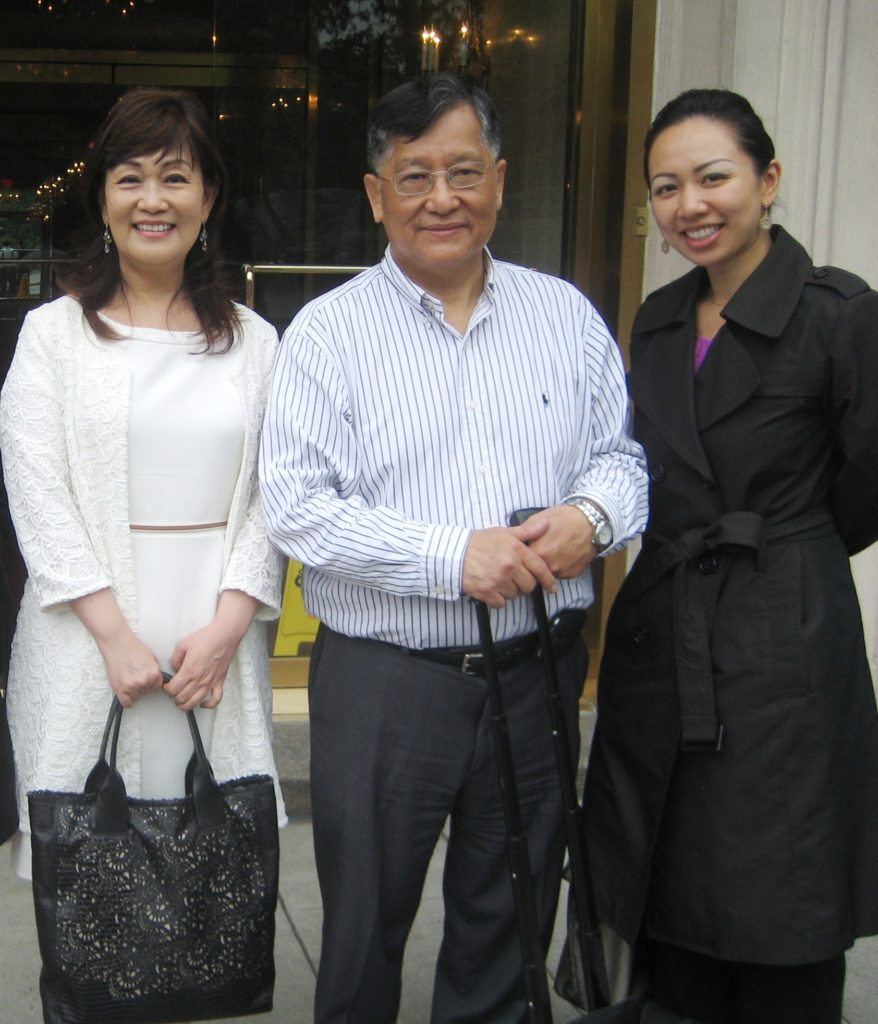 Chinese Speaking Agent Eileen Hsu and Mr. and Mrs. Liu by the condo they purchase.